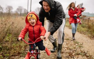 dad son and bike